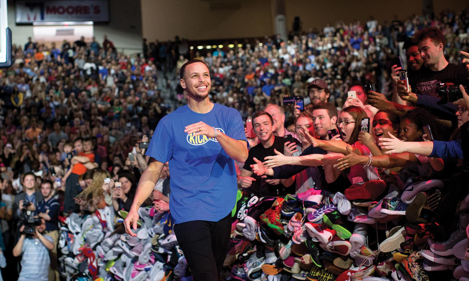 Steph Curry and Liberty University Graduate Donate Thousands of Shoes to Children in Need