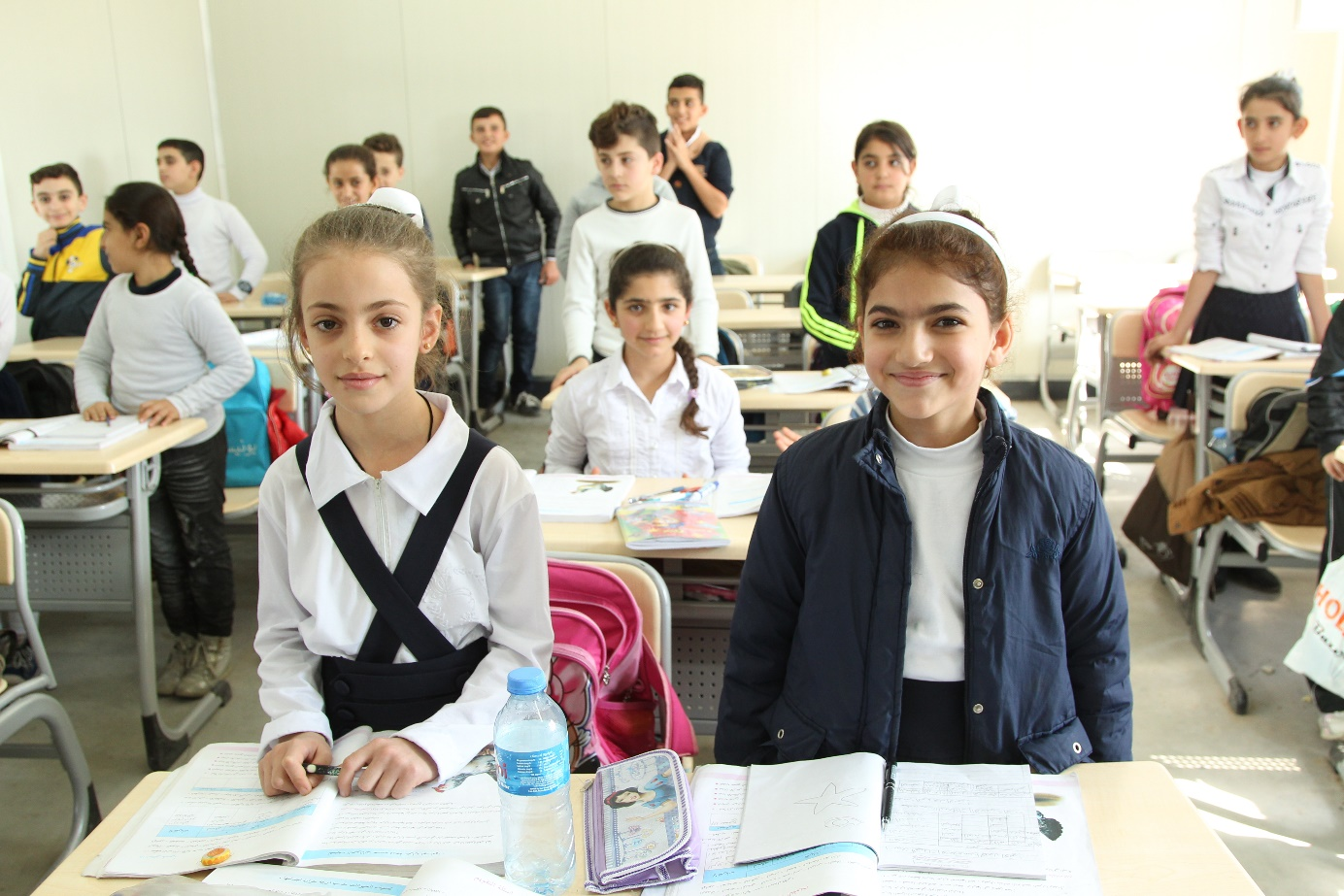 Separated by the flight from ISIS, friends Myriam and Sandra are reunited at a school in Erbil.